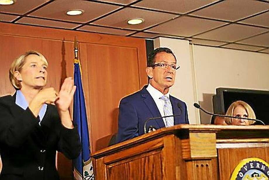Gov. Dannel P. Malloy speaks at a press conference in Hartford. Photo: Hugh McQuaid — CTNewsJunkie.com