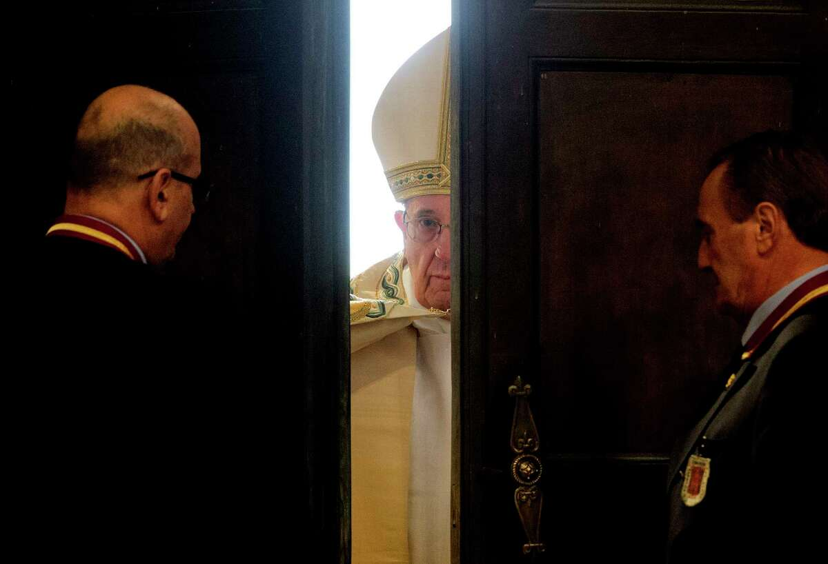 In this Dec. 8, 2015 file photo, Pope Francis opens the Holy Door of St. Peter's Basilica at the Vatican. Pope Francis is on the list of the most notable quotes of 2015, as compiled by a Yale Law School librarian.