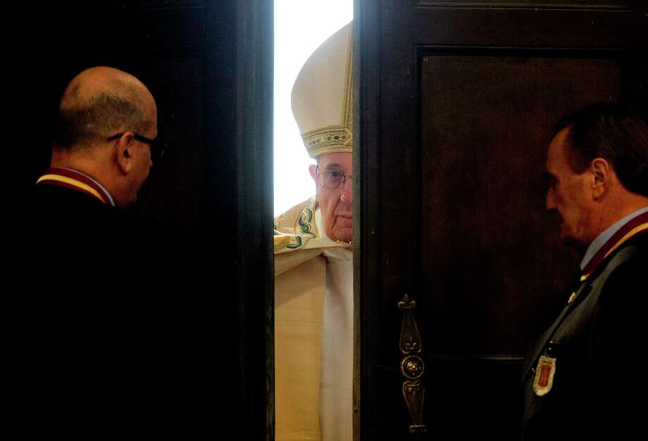 In this Dec. 8, 2015 file photo, Pope Francis opens the Holy Door of St. Peter's Basilica at the Vatican. Pope Francis is on the list of the most notable quotes of 2015, as compiled by a Yale Law School librarian. Photo: AP Photo/Andrew Medichini, File  / AP