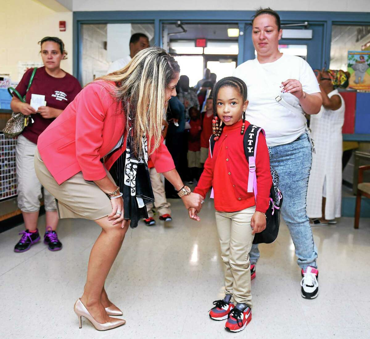(Arnold Gold-New Haven Register) New principal Sandy Kaliszewski greets first grader Keyonna Duarte, 6, on the first day of school at Mauro-Sheridan Interdistrict Magnet School for Science, Technology & Communications in New Haven on 8/28/2014.