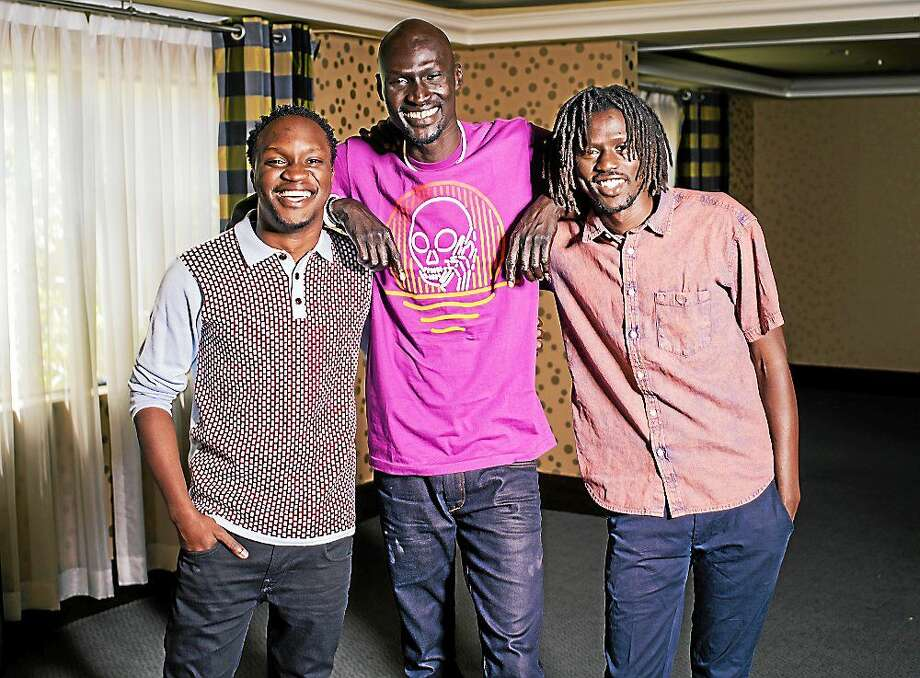"""(Casey Curry/Invision/AP) Arnold Oceng, Ger Duany, and Emmanuel Jal pose for a portrait during press day for """"The Good Lie"""" at Le Montrose Hotel on Sept. 29, 2014 in Los Angeles. Photo: Casey Curry/Invision/AP / Invision"""