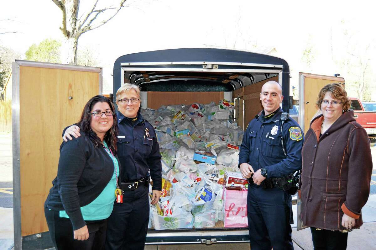 From left are Joy Hollister, Town of Cromwell Human Services Director; Police Chief Denise Lamontagne, Officer Jeremy Perlini, Lisa Olson, Town of Cromwell Human Services assistant and food bank coordinator.