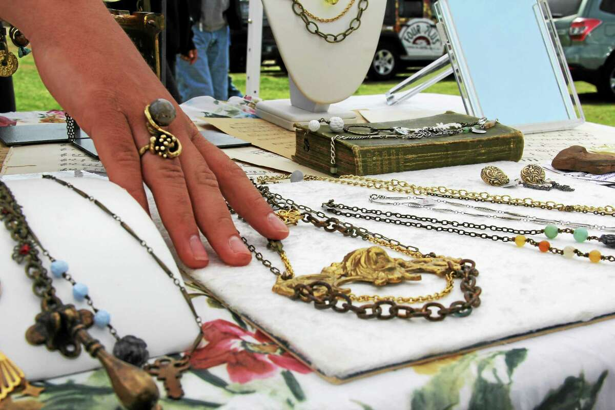 Handmade jewelry crafted by Amanda Proscino, 23, of the Queen of None, is displayed. Proscino has been selling her goods for six years and took part in the small business exposition in Durham.