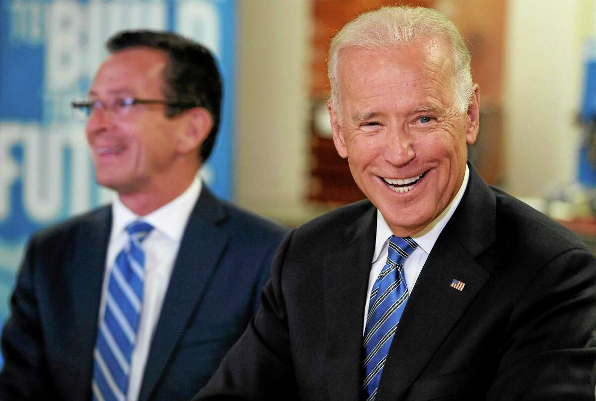 Vice President Joe Biden, right, smiles as he attends a roundtable on workforce development with Connecticut Gov. Dannel P. Malloy, left, at Goodwin College, Wednesday, Aug. 20, 2014, in East Hartford, Conn. (AP Photo/Jessica Hill)