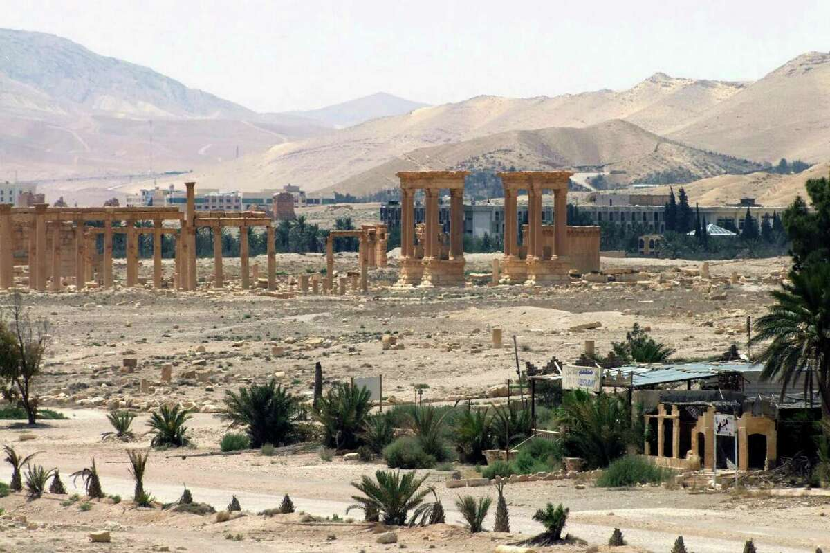 This file photo released on Sunday, May 17, 2015, by the Syrian official news agency SANA, shows the general view of the ancient Roman city of Palmyra, northeast of Damascus, Syria. Activists say Islamic State militants have destroyed a temple at Syria's ancient ruins of Palmyra. News that the militants blew up the Baalshamin Temple came after the extremists beheaded Palmyra scholar Khaled al-Asaad on Tuesday, hanging his bloodied body from a pole in the town's main square.