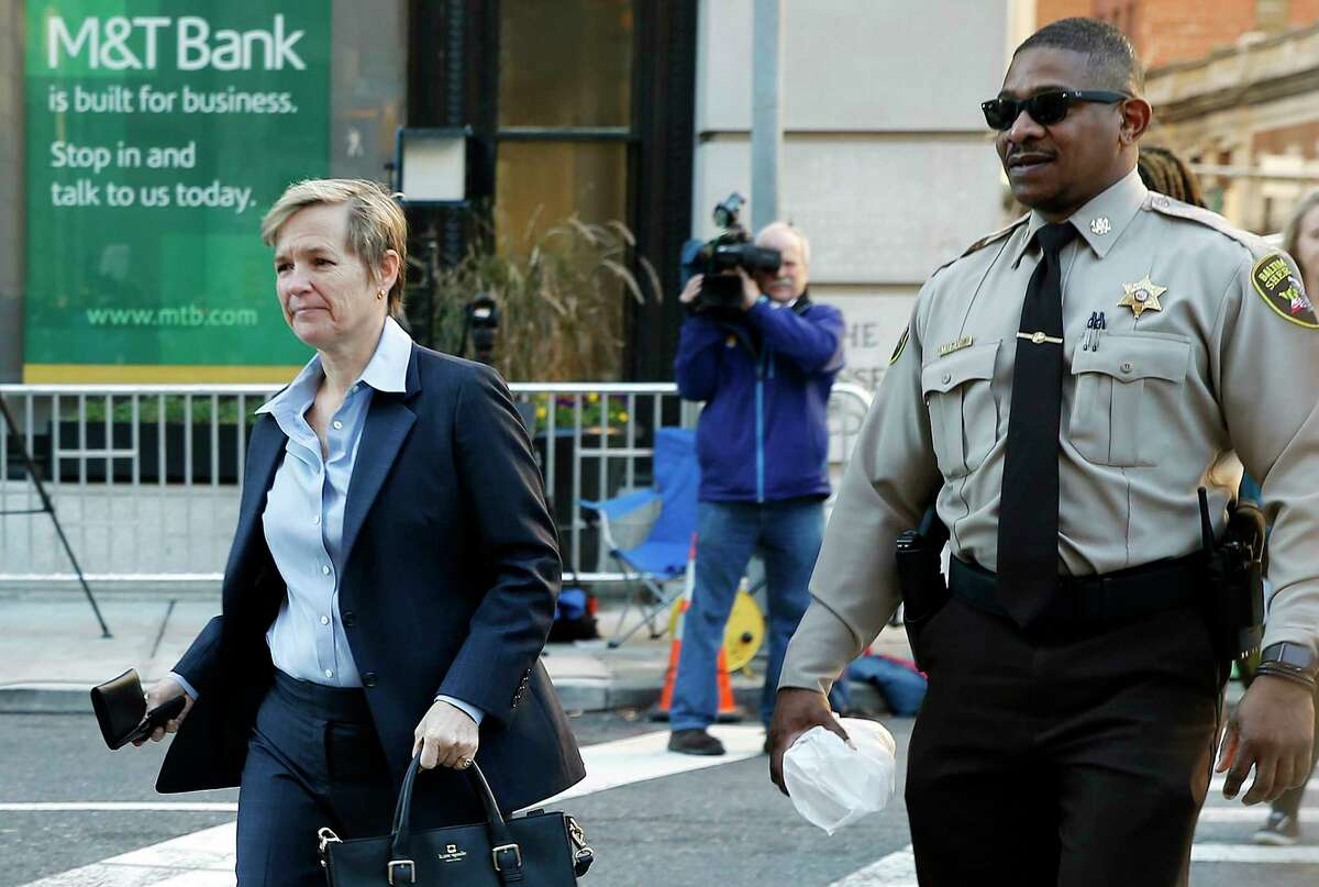 Deputy State's Attorney Janice Bledsoe, left, walks to a courthouse before a jury continues deliberations on the case of William Porter, one of six Baltimore city police officers charged in connection to the death of Freddie Gray, Tuesday, Dec. 15, 2015, in Baltimore.