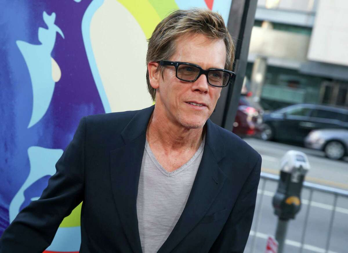 """In this June 2, 2015, file photo, Kevin Bacon arrives at the LA Premiere Of """"Love & Mercy"""" in Beverly Hills, Calif. Bacon will star in a stage adaptation of the story that inspired Alfred Hitchcock's 1954 classic film """"Rear Window."""" Hartford Stage in Connecticut said Tuesday, Aug. 25, 2015, that the movie star will headline the haunting tale of a wheelchair-bound witness to a possible murder. Itís been adapted for the stage by Keith Reddin and will run from Oct. 22-Nov. 15."""