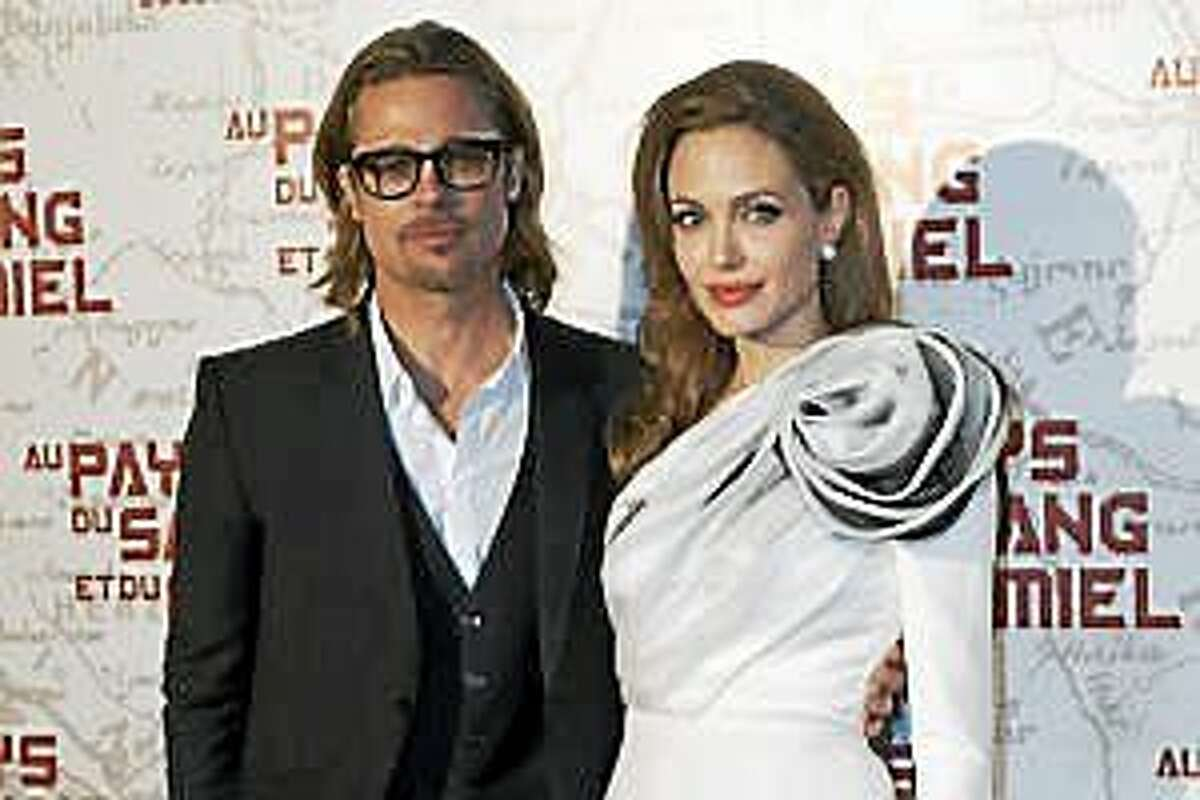 "U.S. actress and director Angelina Jolie, right, and her husband actor Brad Pitt arrive for the screening of her movie ""In The Land of Blood and Honey"", Paris, Thursday, Feb. 16, 2012."