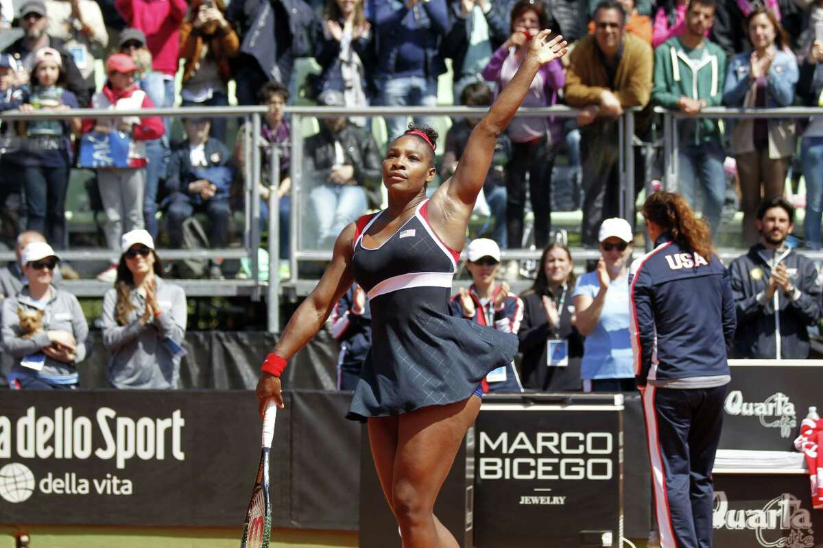 Serena Williams of the United States celebrates after defeating Italy's Sara Errani at the end of a Fed Cup World Group playoff tennis match in Brindisi, Italy, on April 19, 2015. Williams won 4-6, 7-6, 6-3.