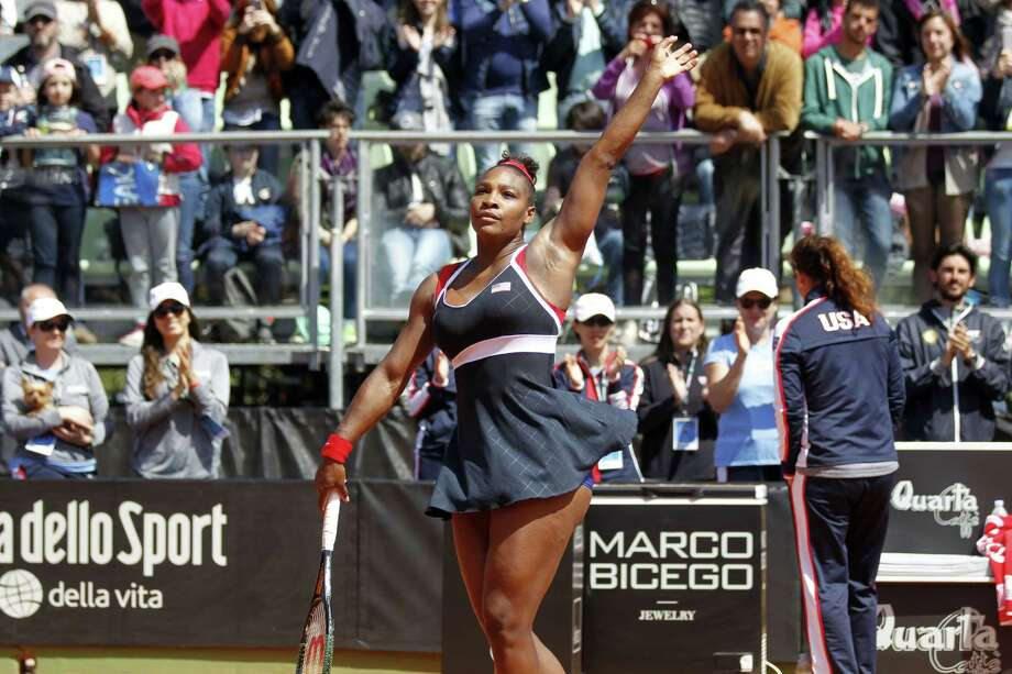 Serena Williams of the United States celebrates after defeating Italy's Sara Errani at the end of a Fed Cup World Group playoff tennis match in Brindisi, Italy, on April 19, 2015. Williams won 4-6, 7-6, 6-3. Photo: AP Photo/Felice Calabro  / AP