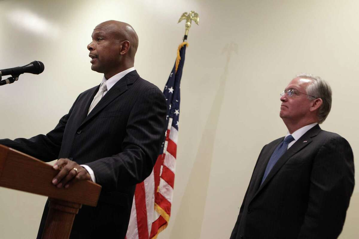 Former St. Louis Police Chief Dan Isom, left, speaks after he is named director of the Missouri Department of Public Safety during a news conference with Gov. Jay Nixon, right, on Wednesday, Aug. 27, 2014, in St. Louis. Nixon appointed Isom nearly three weeks after the police shooting of Michael Brown led to violent protests in a St. Louis suburb. Nixon did not directly say whether the leadership change was related to the events in Ferguson. (AP Photo/St. Louis Post-Dispatch, Huy Mach) EDWARDSVILLE INTELLIGENCER OUT; THE ALTON TELEGRAPH OUT
