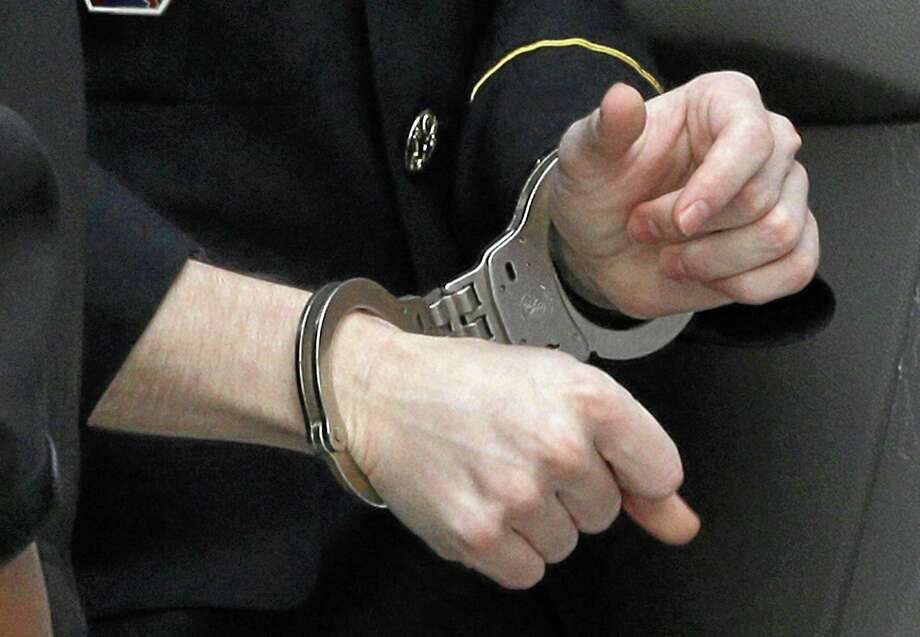 Army Pfc. Bradley Manning wears handcuffs as he is escorted into a courthouse in Fort Meade, Md., Wednesday, Aug. 21, 2013, before a sentencing hearing in his court martial. Manning was sentenced Wednesday to 35 years in prison for giving hundreds of thousands of secret military and diplomatic documents to WikiLeaks. Photo: AP / AP
