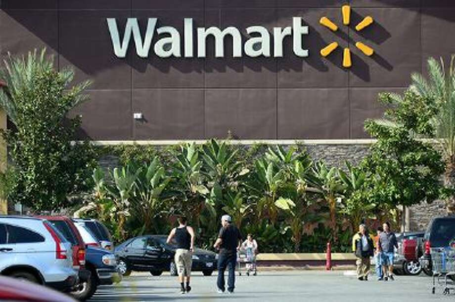 Shoppers are seen outside a Walmart store in Rosemead, California on January 29, 2014, on a day the world's largest retailer said it will tighten inspections on its suppliers in China after it was forced to recall donkey meat products that had been found to contain fox. The US company said it would also change its rules in China to ensure that meat shipments are properly documented before they hit the shelves.  AFP PHOTO FREDERIC J. BROWN        (Photo credit should read FREDERIC J. BROWN/AFP/Getty Images) Photo: AFP/Getty Images / 2014 AFP