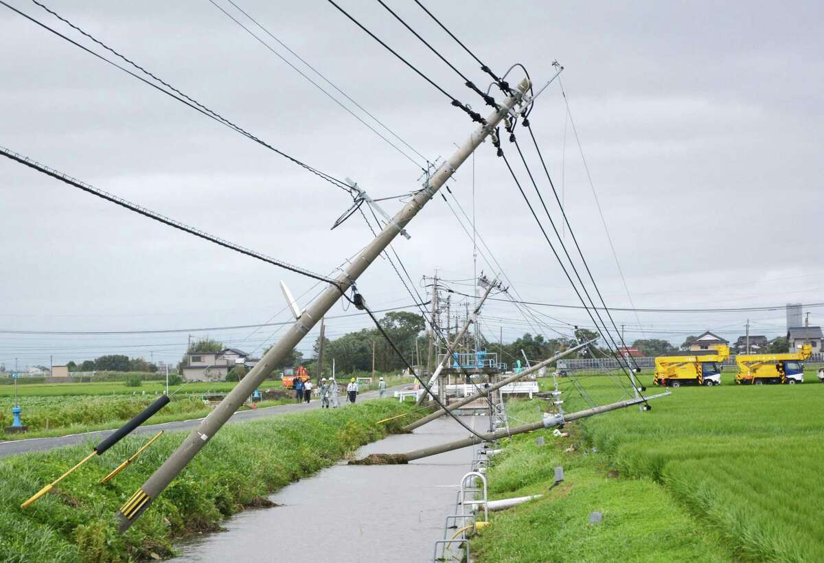 Telephone poles lean after Typhoon Goni hits Kamimine town, Saga prefecture, southwestern Japan, Tuesday, Aug. 25, 2015. The powerful typhoon damaged buildings, tossed around cars and flooded streets in southwestern Japan on Tuesday before heading out to the Sea of Japan.