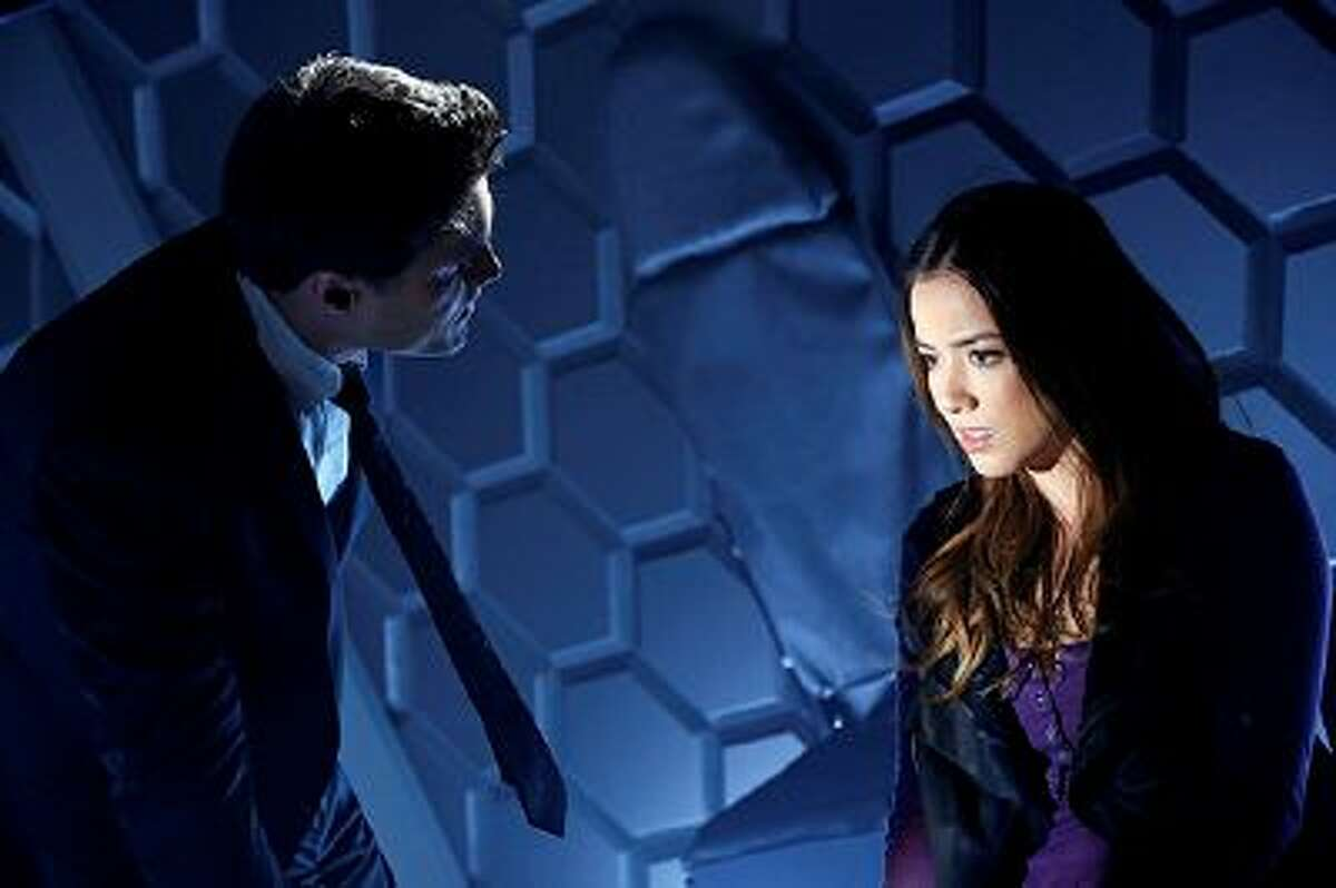 This image released by ABC shows Brett Dalton, left, and Chloe Bennet in a scene from