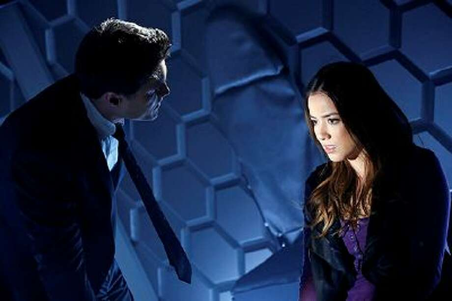 """This image released by ABC shows Brett Dalton, left, and Chloe Bennet in a scene from """"Marvel's Agents of S.H.I.E.L.D.""""  The show premieres Tuesday, Sept. 24, 2013 at 8 p.m. EST on ABC. (AP Photo/ABC/Justin Lubin) Photo: AP / ABC net"""