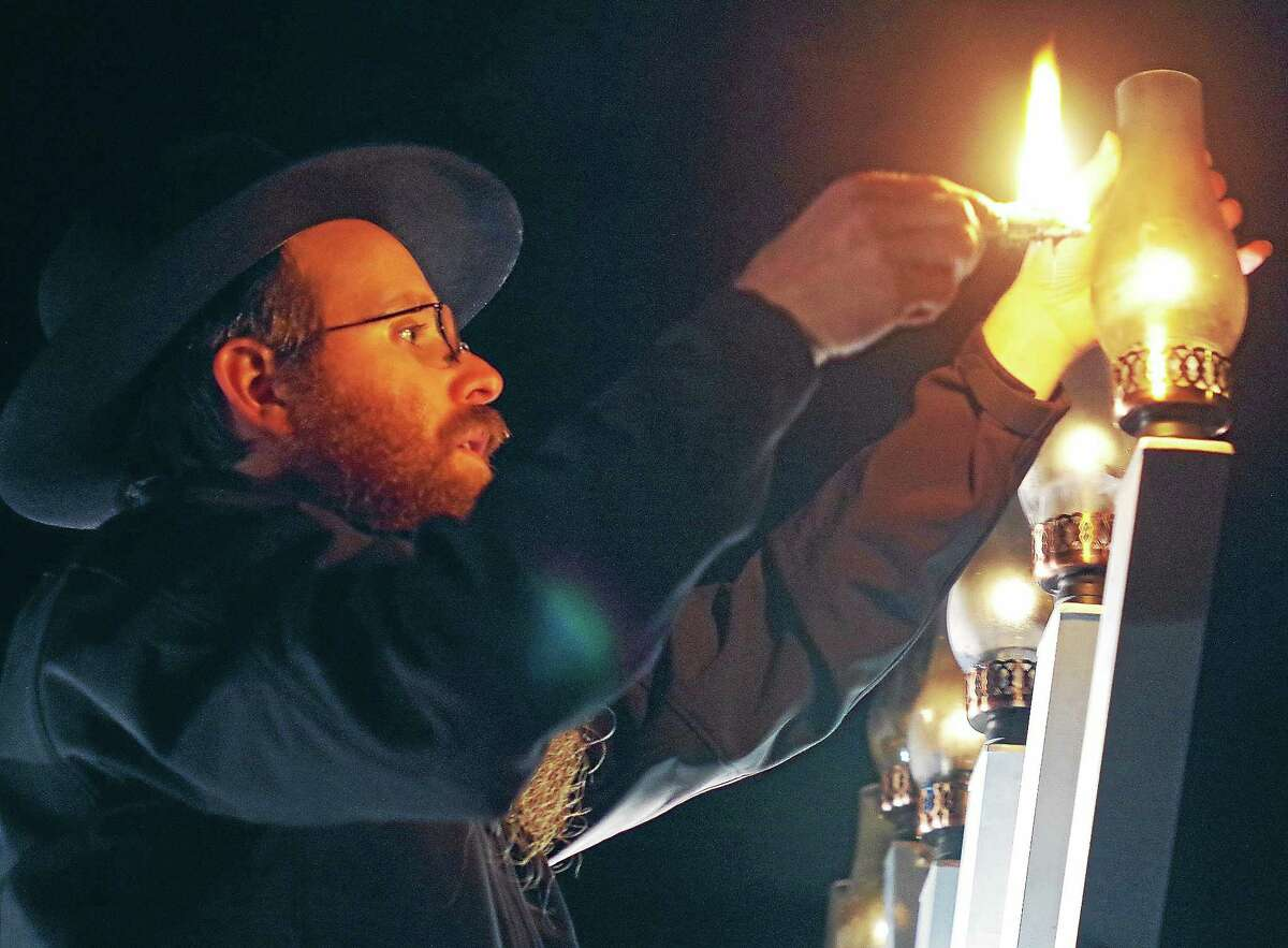 Rabbi Yosef Wolvovsky lights a giant menorah at Union Park in Middletown in this file photo. The sixth annual lighting will take place on the Dec. 23, the last night of Hanukkah.