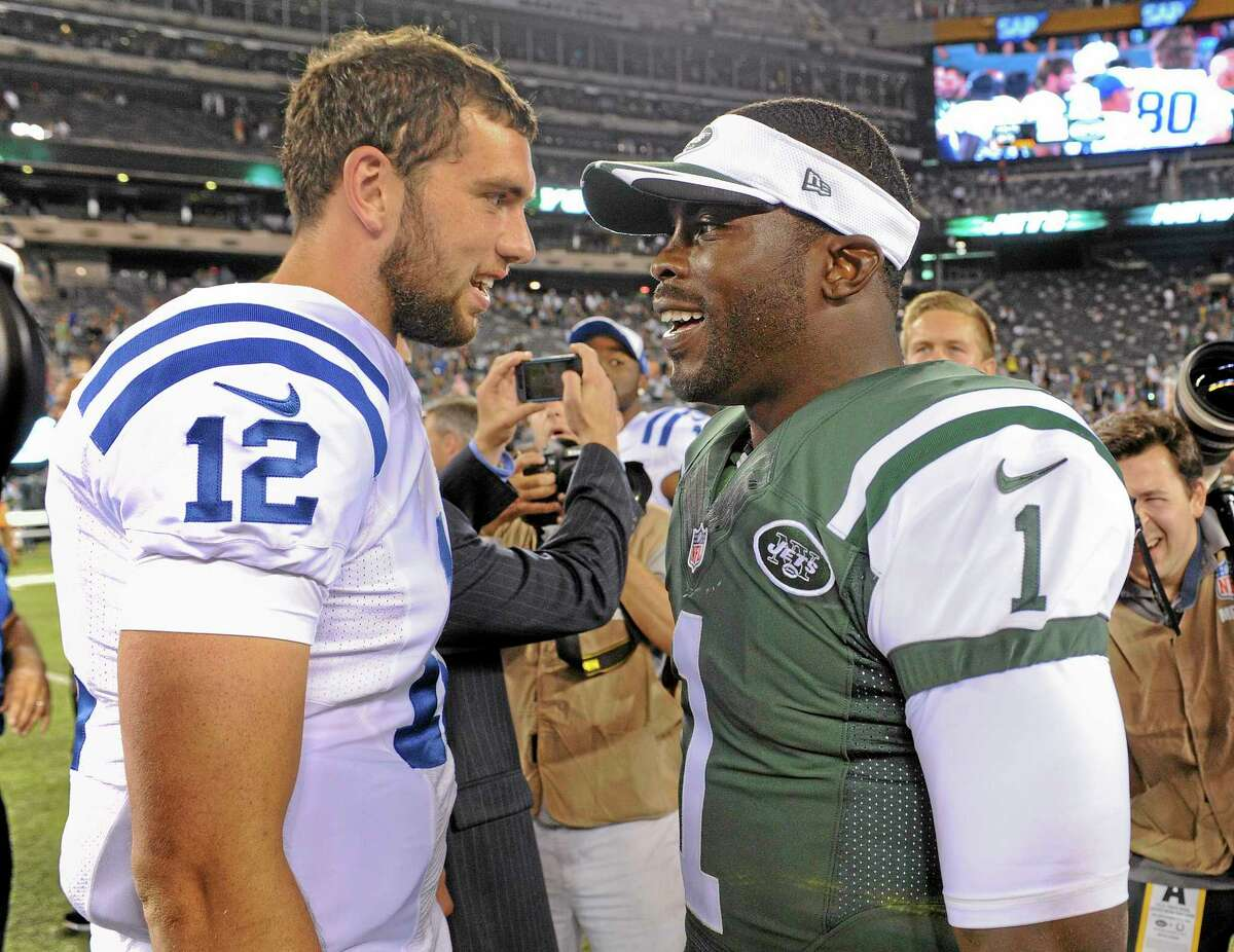 New York Jets quarterback Michael Vick, right, will return to his old home of Philadelphia as a backup. At left is Indianapolis Colts QB Andrew Luck.