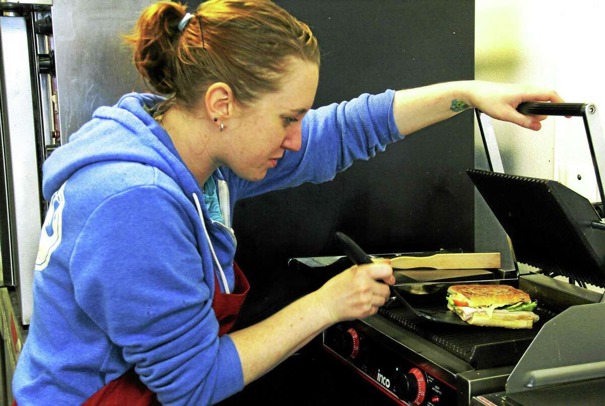 Baker and chief panini maker Angela Thornton of Fusion Bakery in Riverview Center, Middletown, prepares popular hot paninis like chipotle chicken; ham and brie and nutella; and turkey, tuna and grilled cheese for customers.