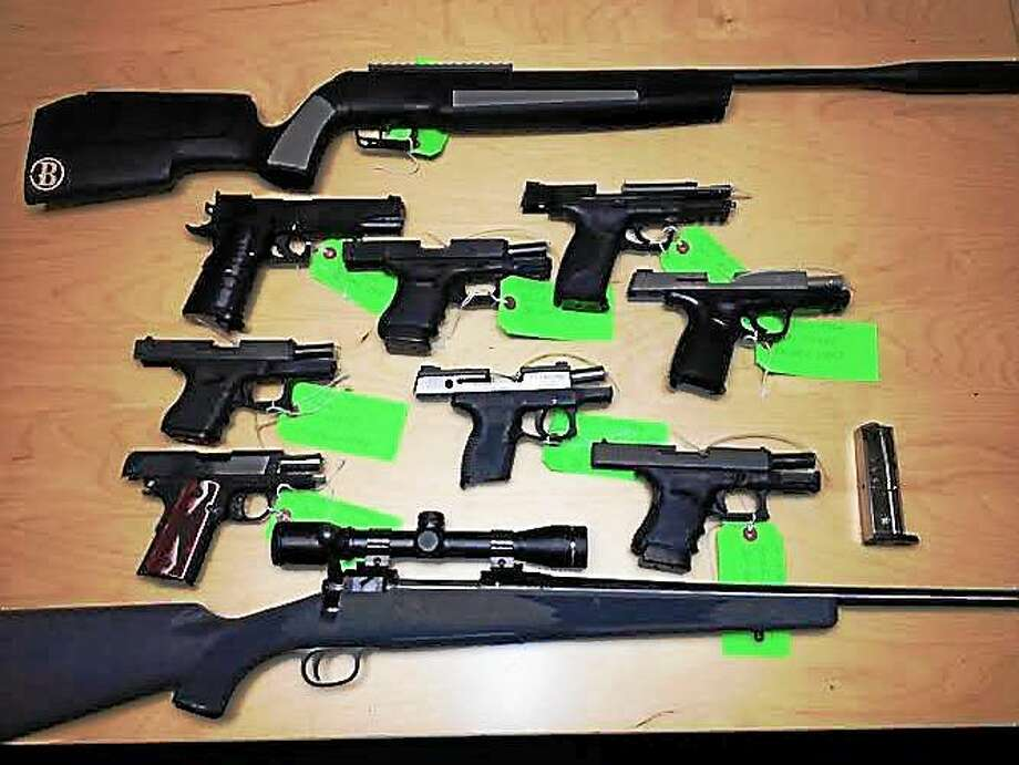 Some of the weapons were allegedly stolen from a gun store on Main Street in Old Saybrook. Police there say they recovered the guns from the home of 25-year-old Thomas Russo after an hour-long standoff. Photo: Journal Register Co.
