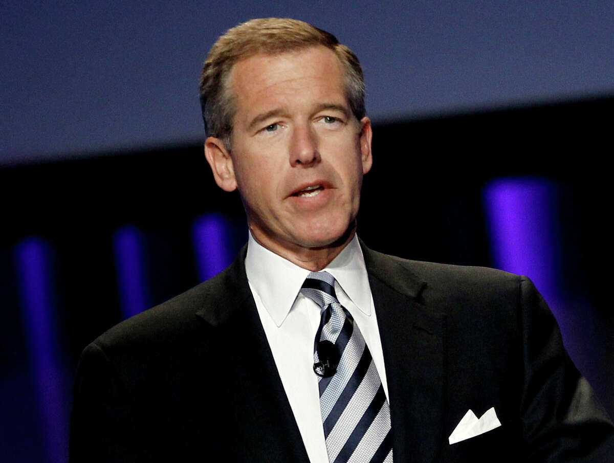 """In this Oct. 26, 2010 file photo, Brian Williams, then anchor and managing editor of """"NBC Nightly News,"""" speaks at the Women's Conference in Long Beach, Calif. A threat of violence against Los Angeles schools brought Williams back on-air for NBC News. In his first appearance since losing his anchor job, Williams handled a NBC News special report Tuesday, Dec. 15, 2015, on the closure of LA public schools."""