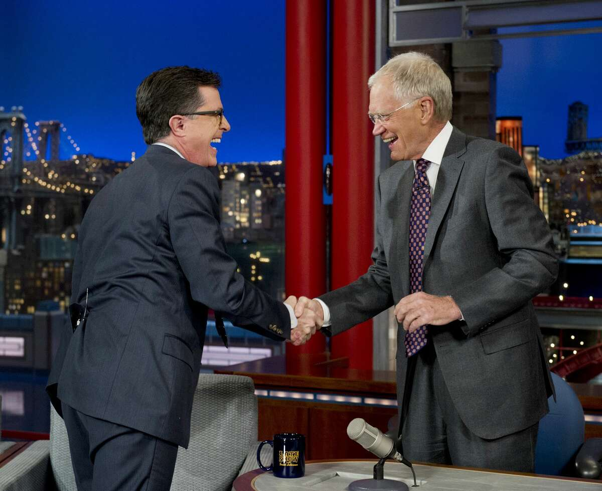 FILE - In this April 22, 2014 file photo provided by CBS, Comedy Centralís Stephen Colbert, left, shakes hands with host David Letterman on the set of the ìLate Show with David Letterman,î in New York. Earlier in April, Letterman announced his retirement in 2015 and CBS announced Colbert as his replacement. (AP Photo/Jeffrey R. Staab) MANDATORY CREDIT, NO SALES, NO ARCHIVE, FOR NORTH AMERICAN USE ONLY