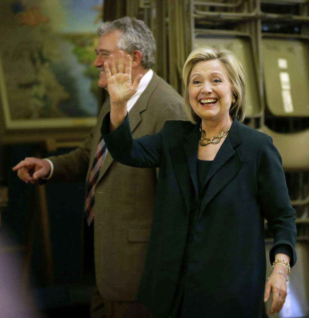 Democratic presidential candidate Hillary Rodham Clinton waves as she arrives at the Iowa Statehouse to meet with Democratic Party lawmakers on April 15, 2015, in Des Moines, Iowa.