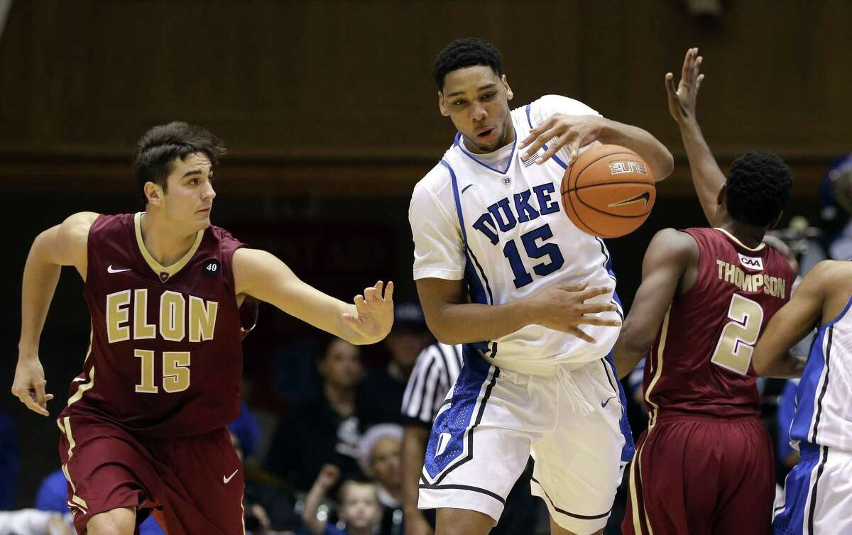 Duke's Jahlil Okafor grabs the ball as Elon's Tony Sabato, left, and Dmitri Thompson defend during the second half of the Blue Devils' 75-62 win on Monday in Durham, N.C.