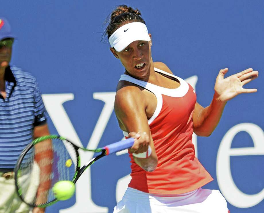 Madison Keys of the USA reaches to hit a return to Elina Svitolina of Ukraine in their singles match at the Connecticut Open in New Haven Monday, Aug. 24, 2015. Photo by Bob Child Photo: Journal Register Co.