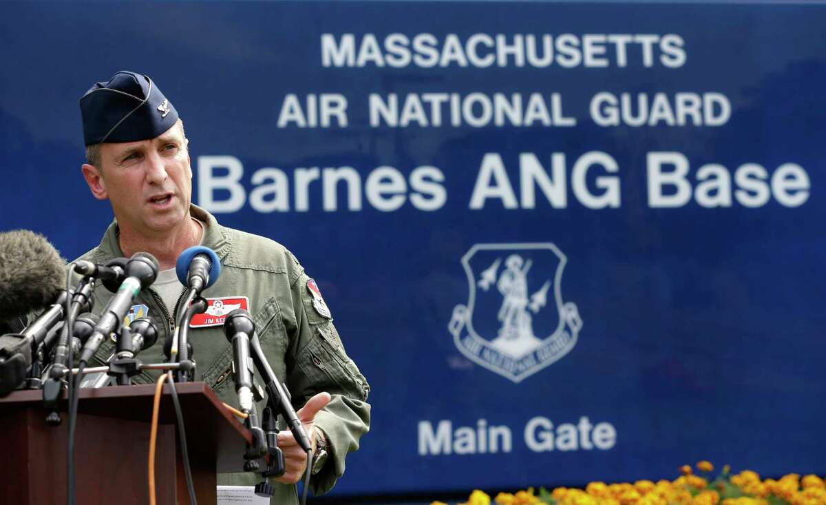 U.S. Air National Guard Col. James Keefe, commander of the 104th Fighter Wing, takes questions from reporters in front of Barnes Air National Guard Base, in Westfield, Mass., Wednesday, Aug. 27, 2014, about a crashed Massachusetts Air National Guard F-15C fighter.
