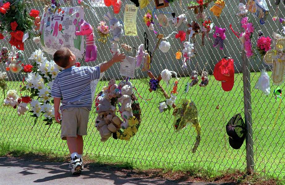 In this May 21, 1997 photo, Sean Caraff of Denver visits the fence that surrounds the remains of the Alfred P. Murrah Federal Building in downtown Oklahoma City. Photo: AP Photo/Gail Oskin  / AP