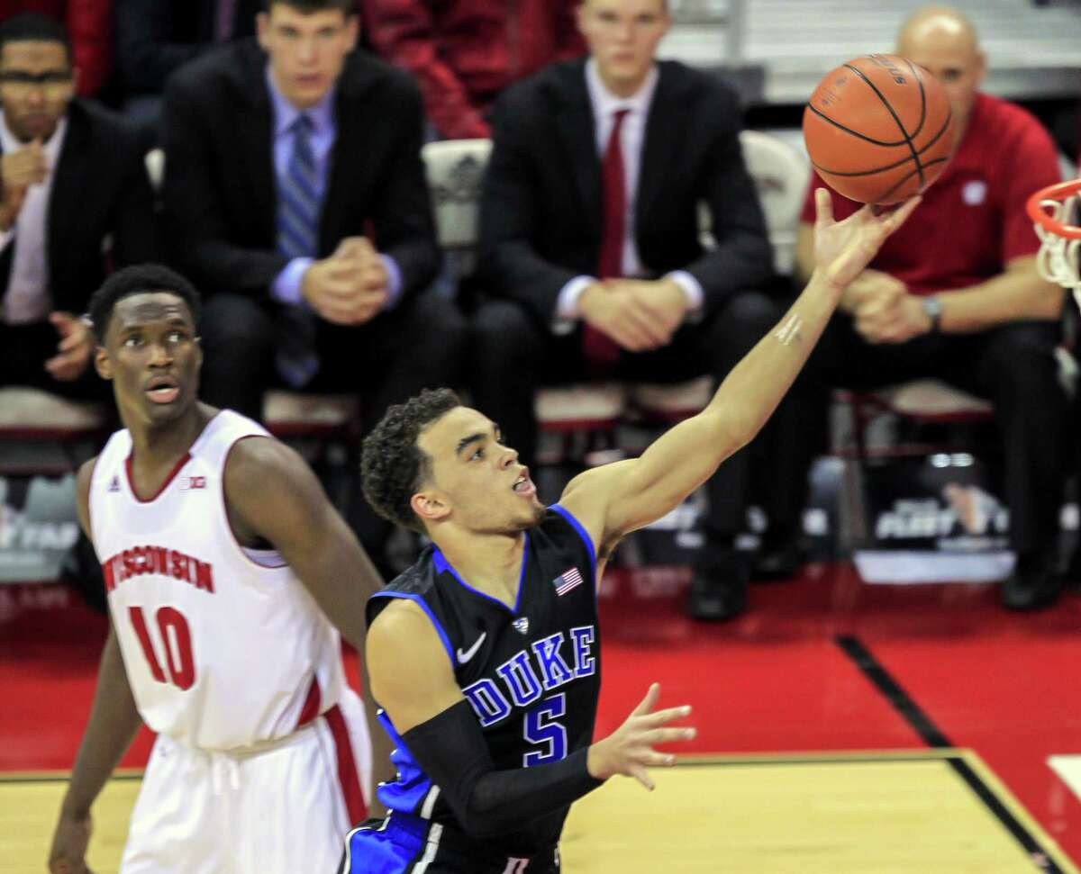 Duke's Tyus Jones shoots past Wisconsin's Nigel Hayes during the first half of the Blue Devils' 80-70 win on Dec. 3 in Madison, Wis.