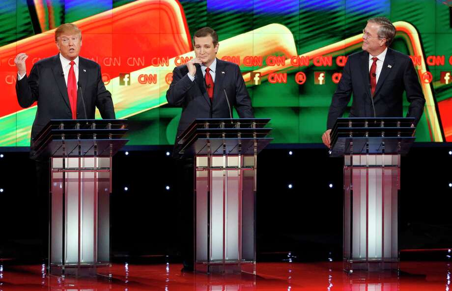 Donald Trump, left, speaks as Ted Cruz, center, and Jeb Bush watch during the CNN Republican presidential debate at the Venetian Hotel & Casino Tuesday in Las Vegas. Photo: John Locher — The Associated Press  / AP