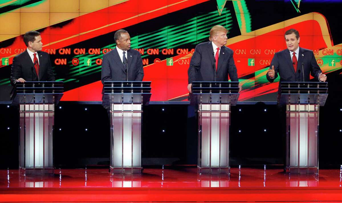 Ted Cruz, right, speaks as Marco Rubio, left, Ben Carson, second from left, and Donald Trump watch during the CNN Republican presidential debate at the Venetian Hotel & Casino Tuesday in Las Vegas.