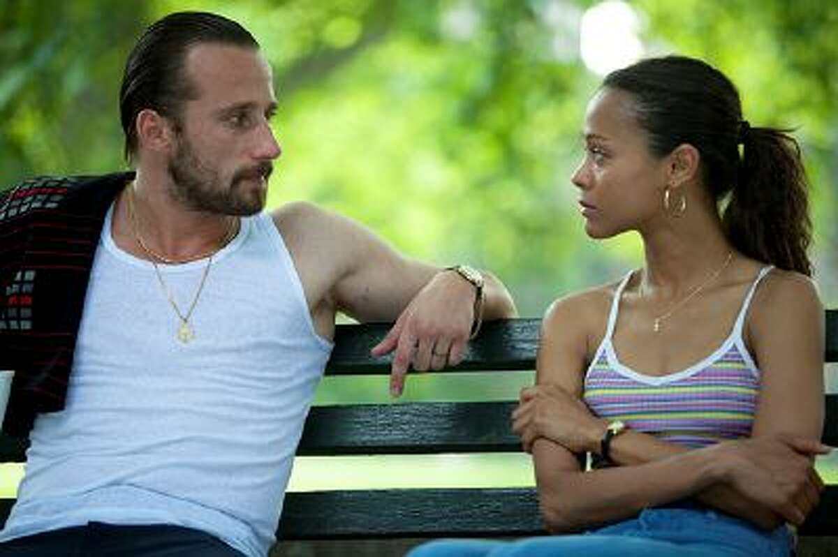 This image released by Roadside Attractions shows Matthias Schoenaerts, left, and Zoe Saldana in a scene from