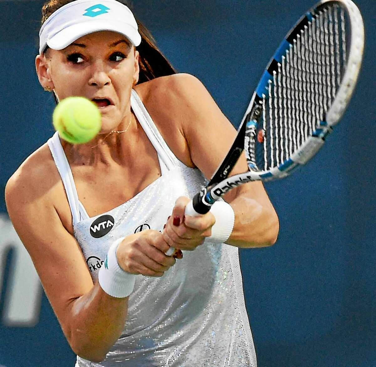(Peter Hvizdak - New Haven Register) Agnieszka Radwanska of Poland plays a first set volley against CoCo Vandeweghe of the U.S.A.during a Connecticut Open tennis Stadium court match in New Haven Monday evening August 24, 2015.