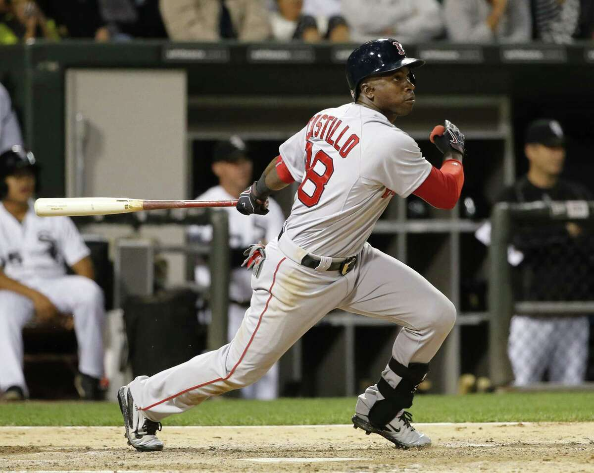 Boston Red Sox's Rusney Castillo watches his two-run double during the fifth inning of a baseball game Monday, Aug. 24, 2015, in Chicago. (AP Photo/Charles Rex Arbogast)