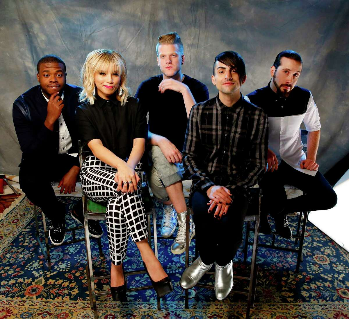 FILE - In this Sept. 4, 2015 photo, Kevin Olusola, from left, Kristie Maldonado, Scott Hoying, Mitch Grassi and Avi Kaplan of the group Pentatonix pose for a portrait at Sony Music Nashville in Nashville, Tenn. Pentatonix, Macklemore and Ryan Lewis, Nick Jonas and OMI will be ringing in the New Year from Hollywood for