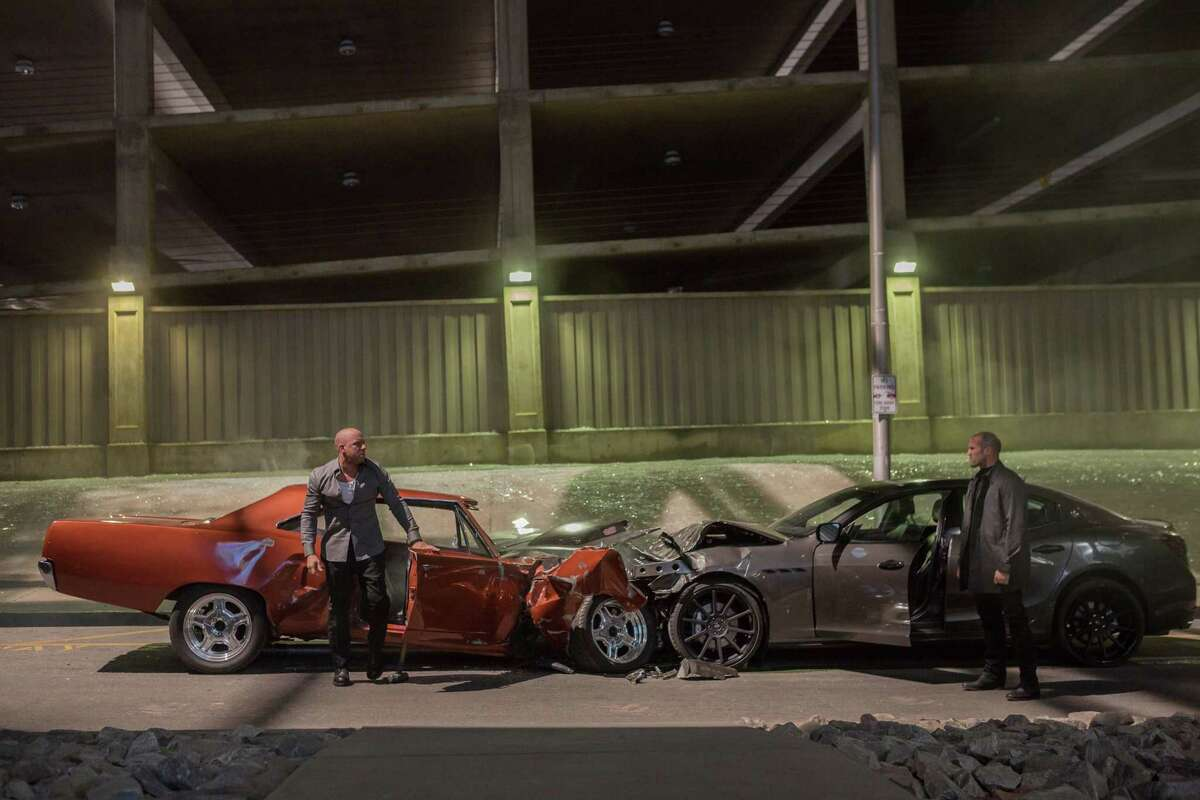 "This photo provided by Universal Pictures shows, Vin Diesel, left, as Dom Toretto, and Jason Statham, as Deckard Shaw, in a scene from ""Furious 7."""