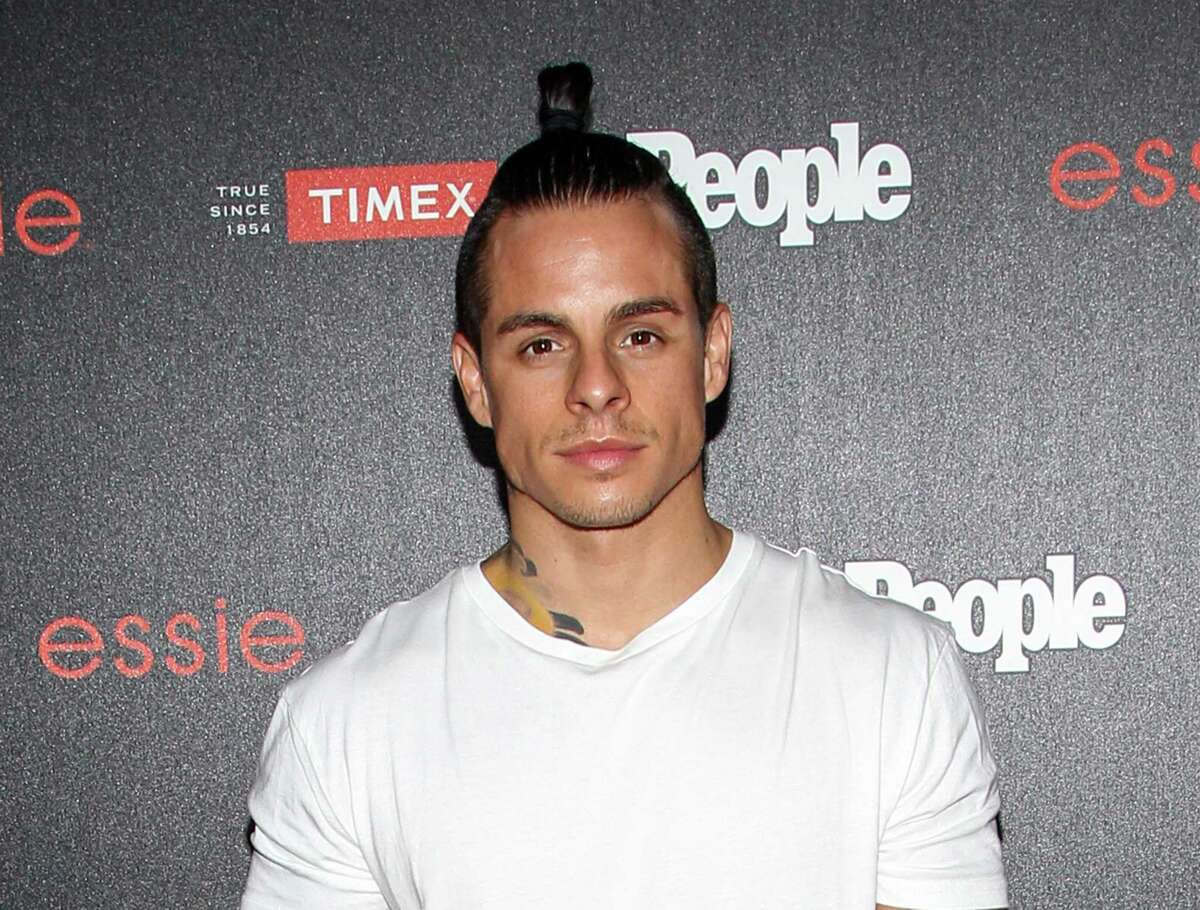 """In this Oct. 9, 2014, file photo, dancer Casper Smart sports a man bun as he attends the People """"Ones to Watch"""" Party in Los Angeles."""