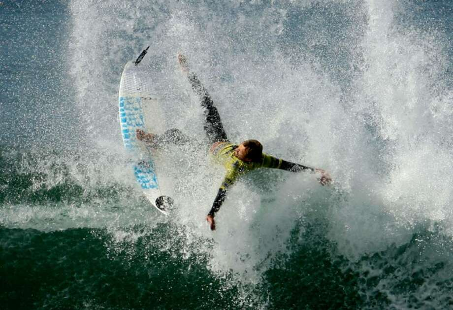 In appreciation of this Sunday's International Surfing Day, celebrated annually on or near the summer solstice, here are some gnarly images from the archives. Photo: Lucas Dawson, Getty Images / Getty Images