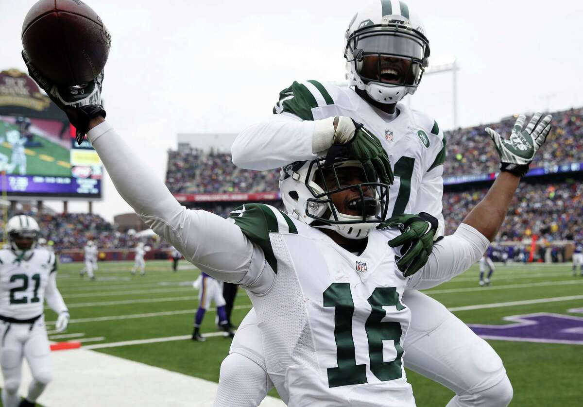 New York Jets receiver Percy Harvin (16) celebrates with teammate Jeremy Kerley after catching a 35-yard touchdown pass during a Dec. 7 game against the Minnesota Vikings in Minneapolis.