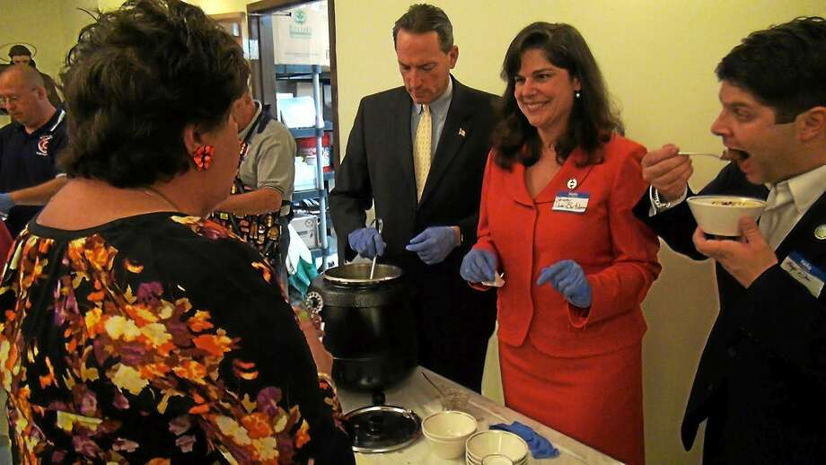 The annual Amazing Challenge Soup Supper raises funds to allow Middletown's food pantry run by the St. Vincent De Paul Place to continue serving nearly 1,000 families each month. Here, state Sens. Paul Doyle and Dante Bartolomeo help out. Photo: Courtesy Photo