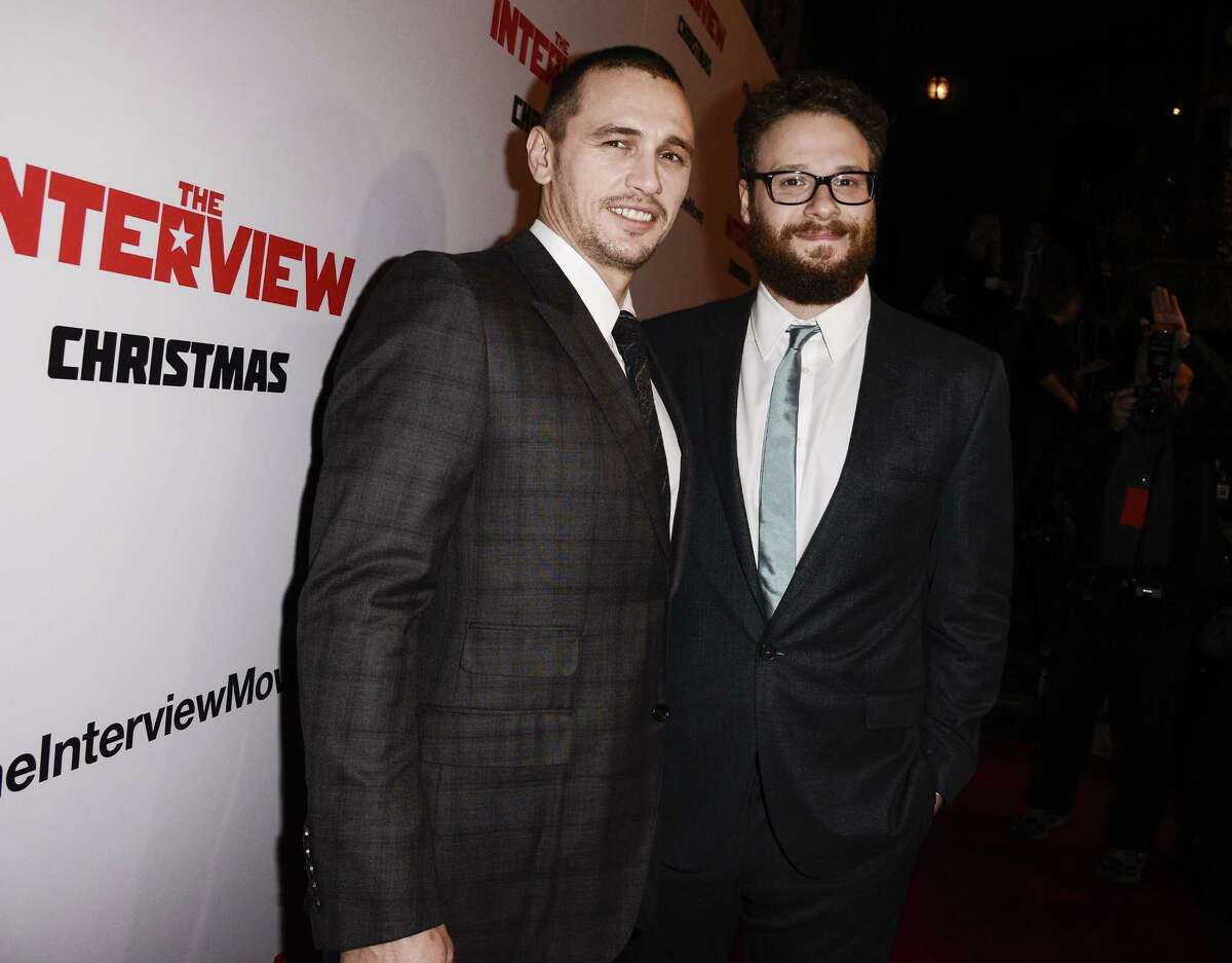 """In this Dec. 11, 2014 photo, actors Seth Rogen, right, and James Franco attend the premiere of the Sony Pictures' film """"The Interview"""" in Los Angeles."""