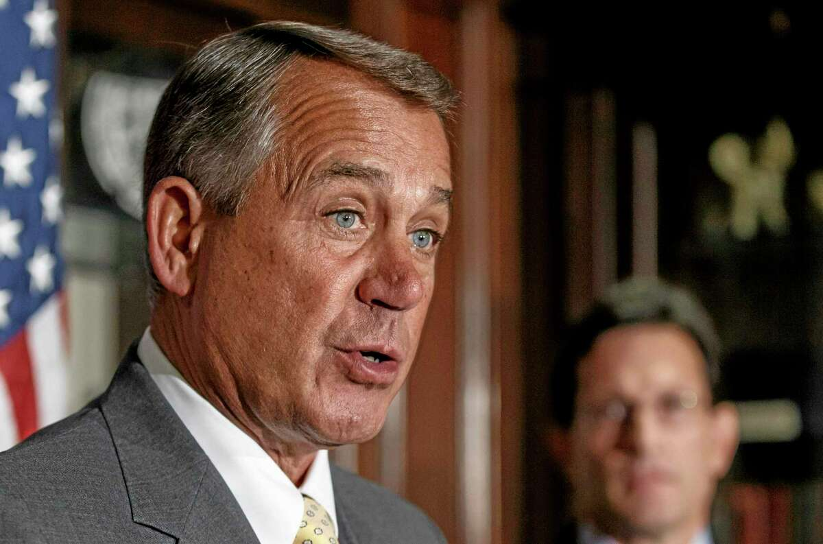 FILE - This Jan. 28, 2014 file photo shows House Speaker John Boehner of Ohio, left, accompanied by House Majority Leader Eric Cantor of Va. speaking at Republican National Committee headquarters in Washington. (AP Photo/J. Scott Applewhite, File)