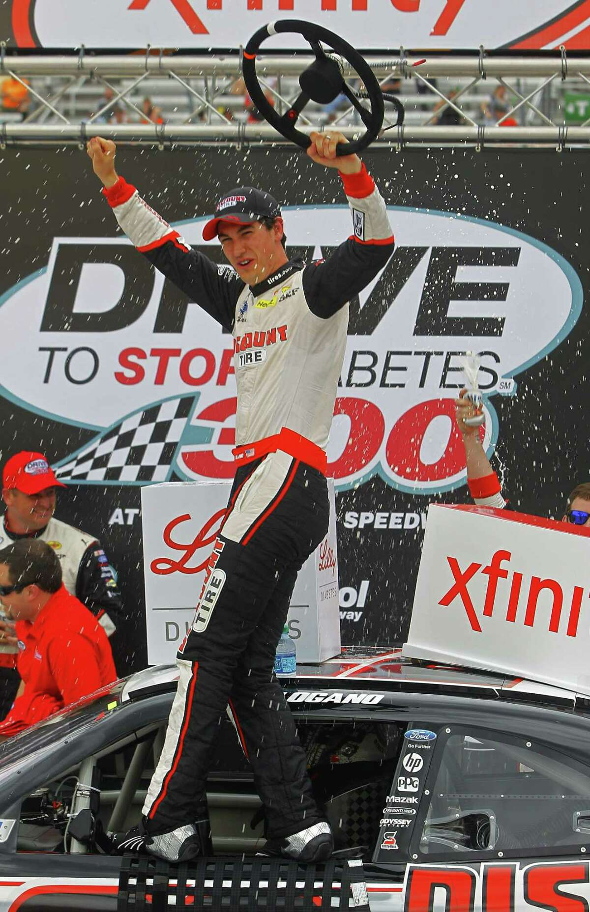 Middletown's Joey Logano celebrates in Victory Lane after winning the NASCAR Xfinity Series race on Saturday at Bristol Motor Speedway in Bristol, Tenn.