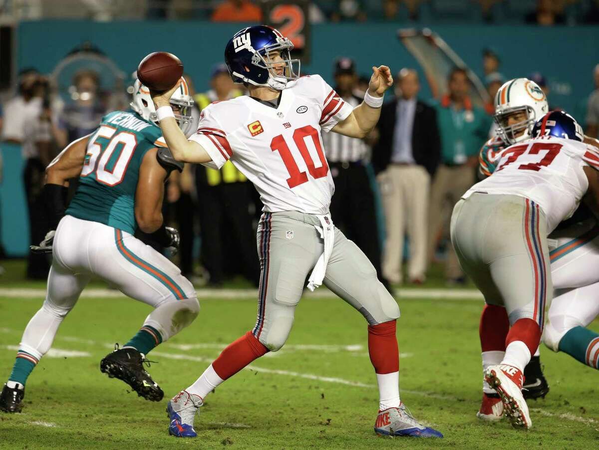 Giants quarterback Eli Manning winds to pass during the first half of Monday's game against the Dolphins.