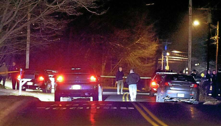 Police investigate the deaths in a house on the 700 block of Cornwall Avenue in Cheshire Tuesday evening. Photo: Peter Hvizdak — New Haven Register  / ©2014 Peter Hvizdak