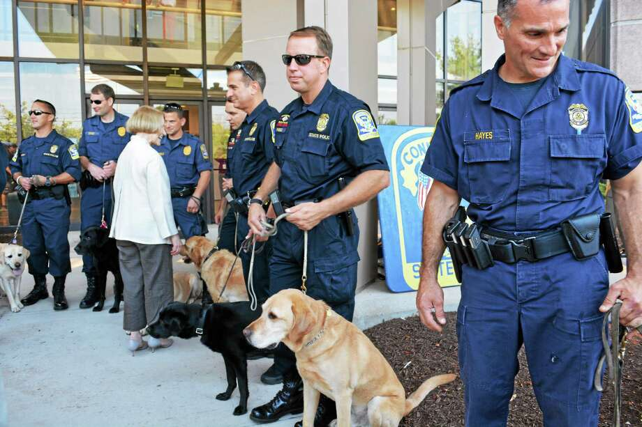 The Connecticut State Police Canine Memorial was unveiled Thursday at a ceremony at headquarters in Middletown. Photo: Kaitlyn Schroyer - The Middletown Press