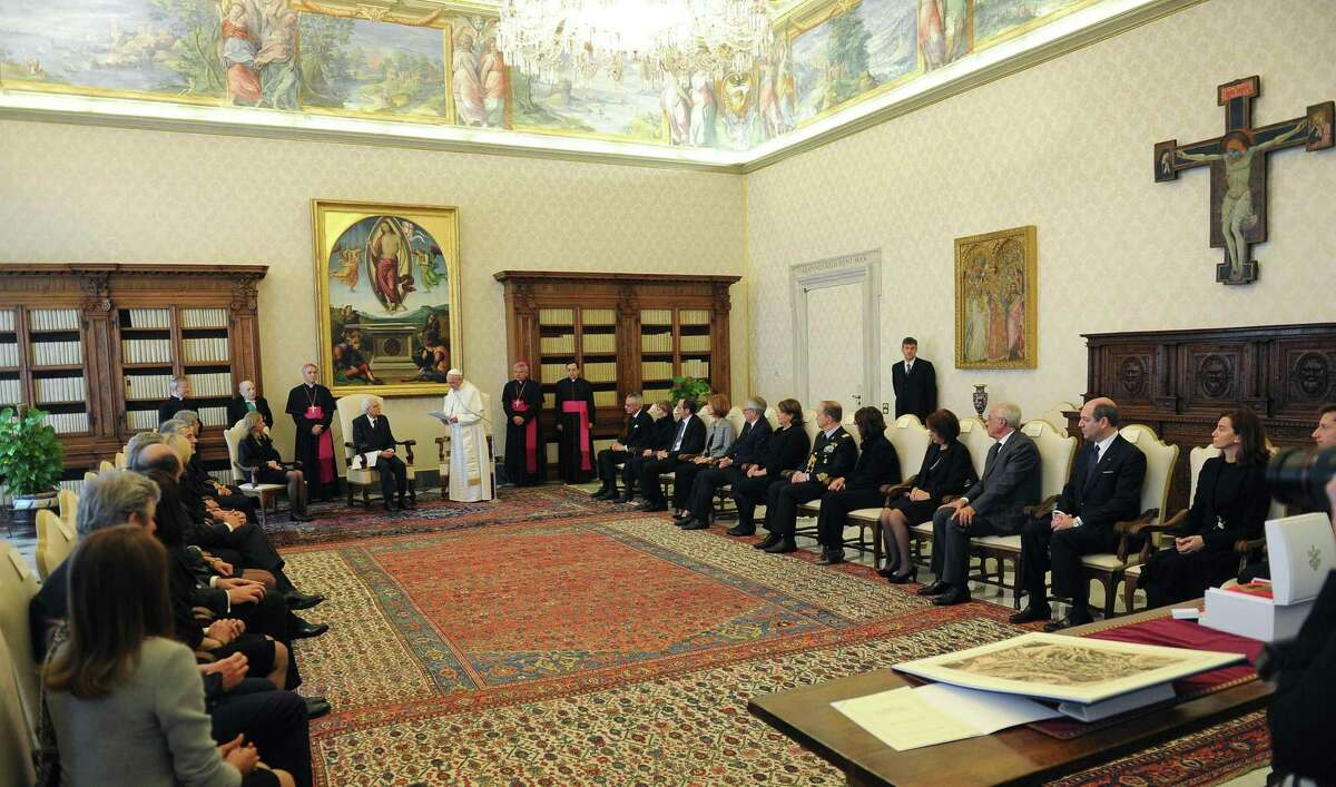 Pope Francis talks with Italian President Sergio Mattarella during a private audience, in the pontiff's studio at the Vatican, Saturday, April 18, 2015. (Maurizio Brambatti/POOL Photo via AP)